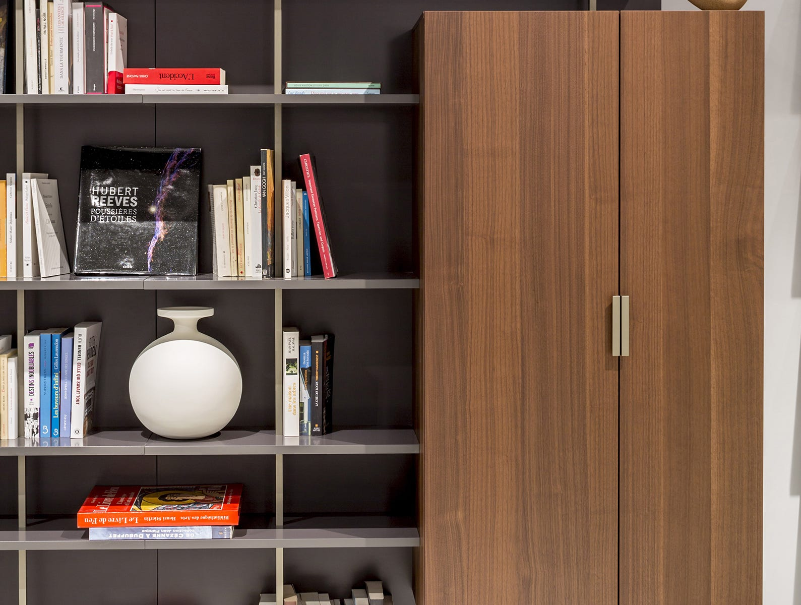 Look closely: This hybrid from Ligne Roset is a simple grid, but its shelves extend beyond the frame, and shaking up the design even more is floating closed storage in dark walnut (to contrast with the lacquer finish), further eye-catching because the door is asymmetrical. Hardware is bronze lacquer, and lacquer cabinetry accented with bronze supports comes in black (as shown), brick or moutarde, a mustard shade for pop.