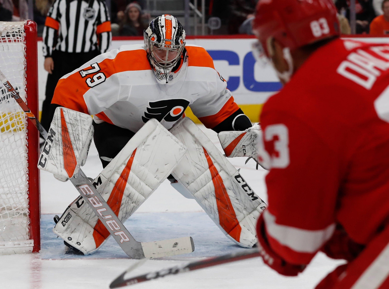 Detroit Red Wings defenseman Trevor Daley (83) shoots towards Philadelphia Flyers goaltender Carter Hart (79) during the second period.