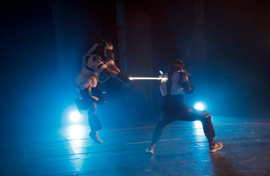 """Competitors battle during a national lightsaber tournament in Beaumont-sur-Oise, north of Paris. """"We wanted it to be safe, we wanted it to be umpired and, most of all, we wanted it to produce something visual that looks like the movies, because that is what people expect,"""" said Michel Ortiz, the tournament organizer."""