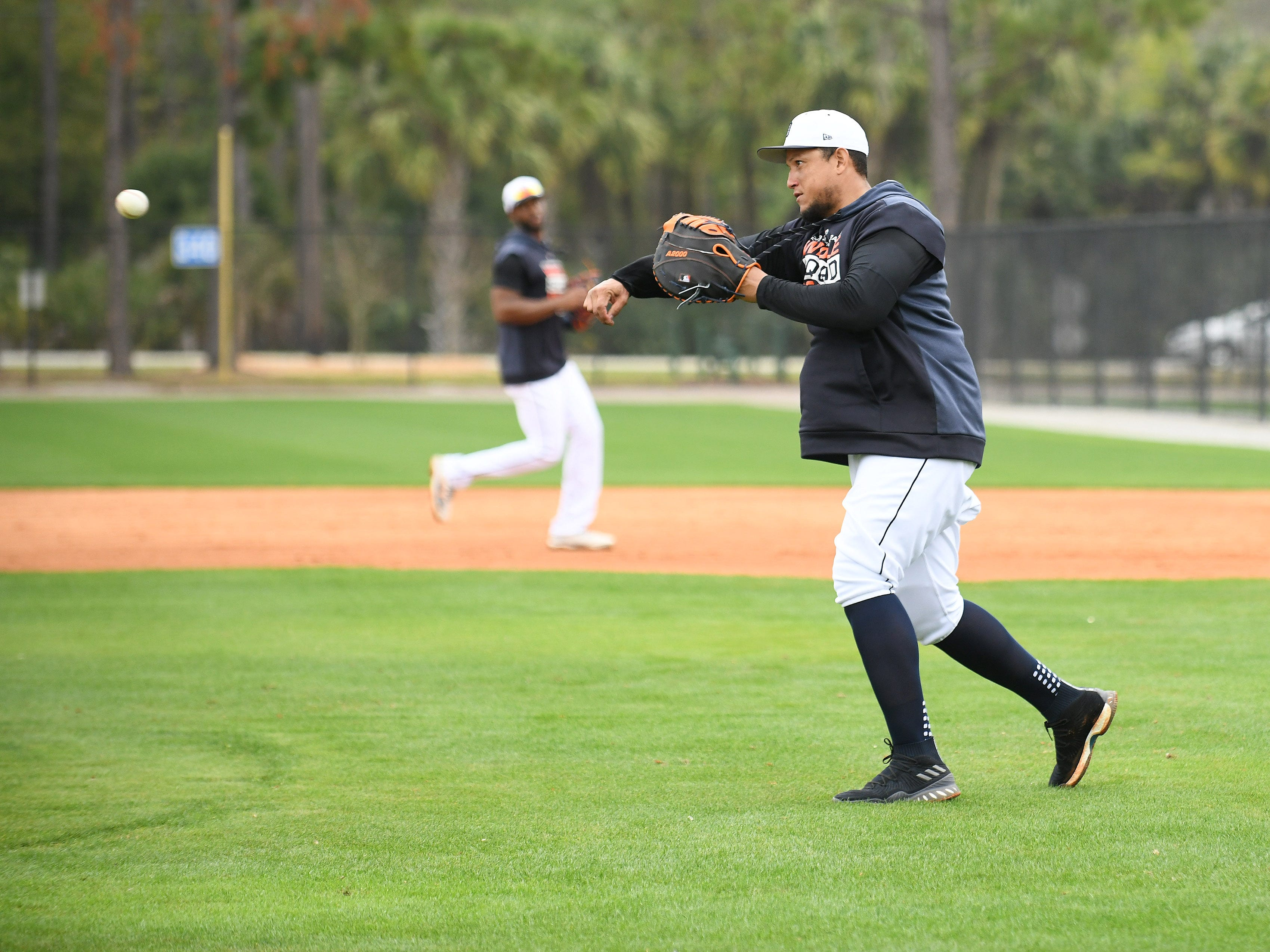 Tigers first baseman Miguel Cabrera throws to third base during infield drills.