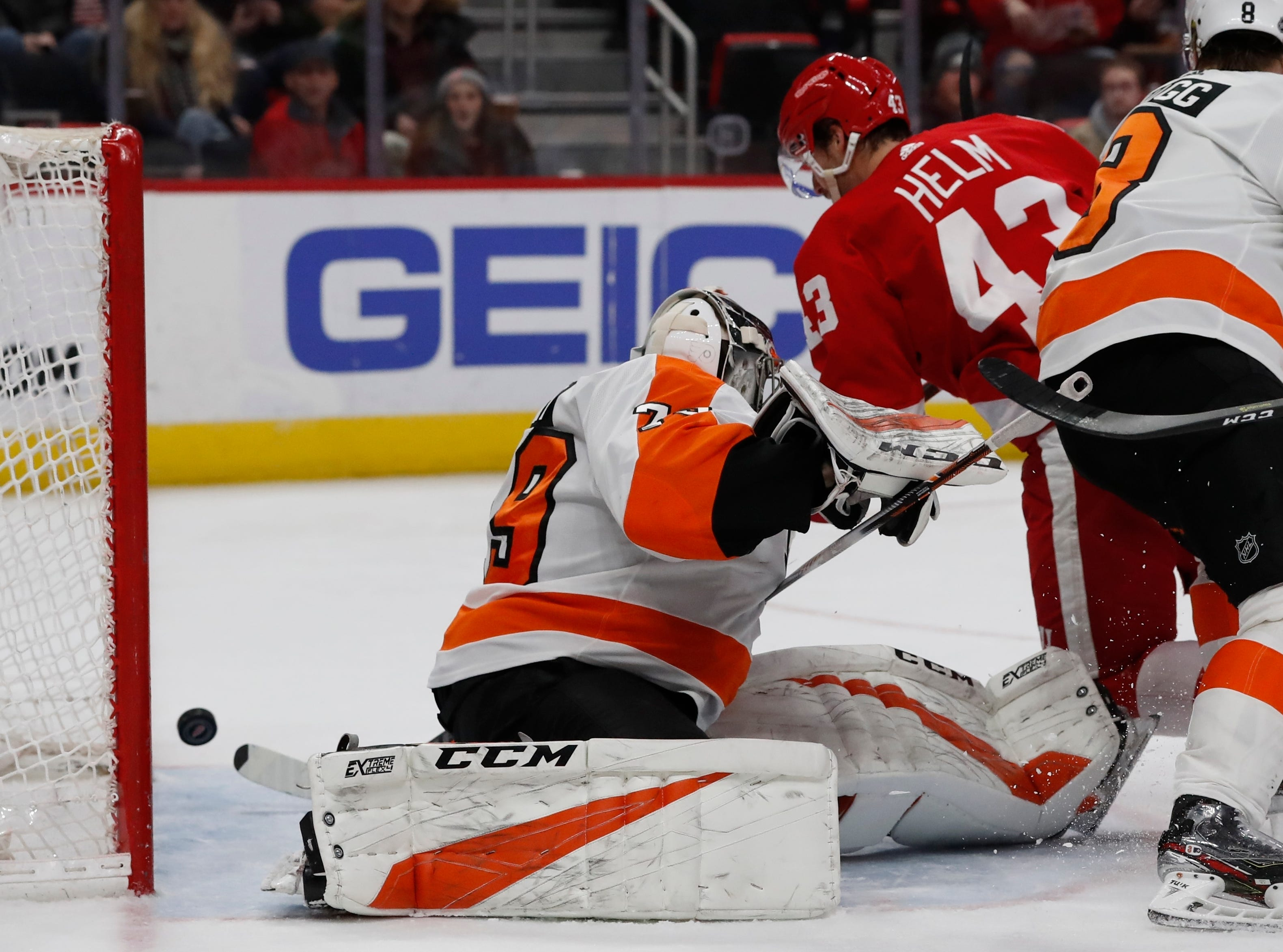 Detroit Red Wings left wing Darren Helm (43) shoots the puck past Philadelphia Flyers goaltender Carter Hart (79) for a goal during the second period.