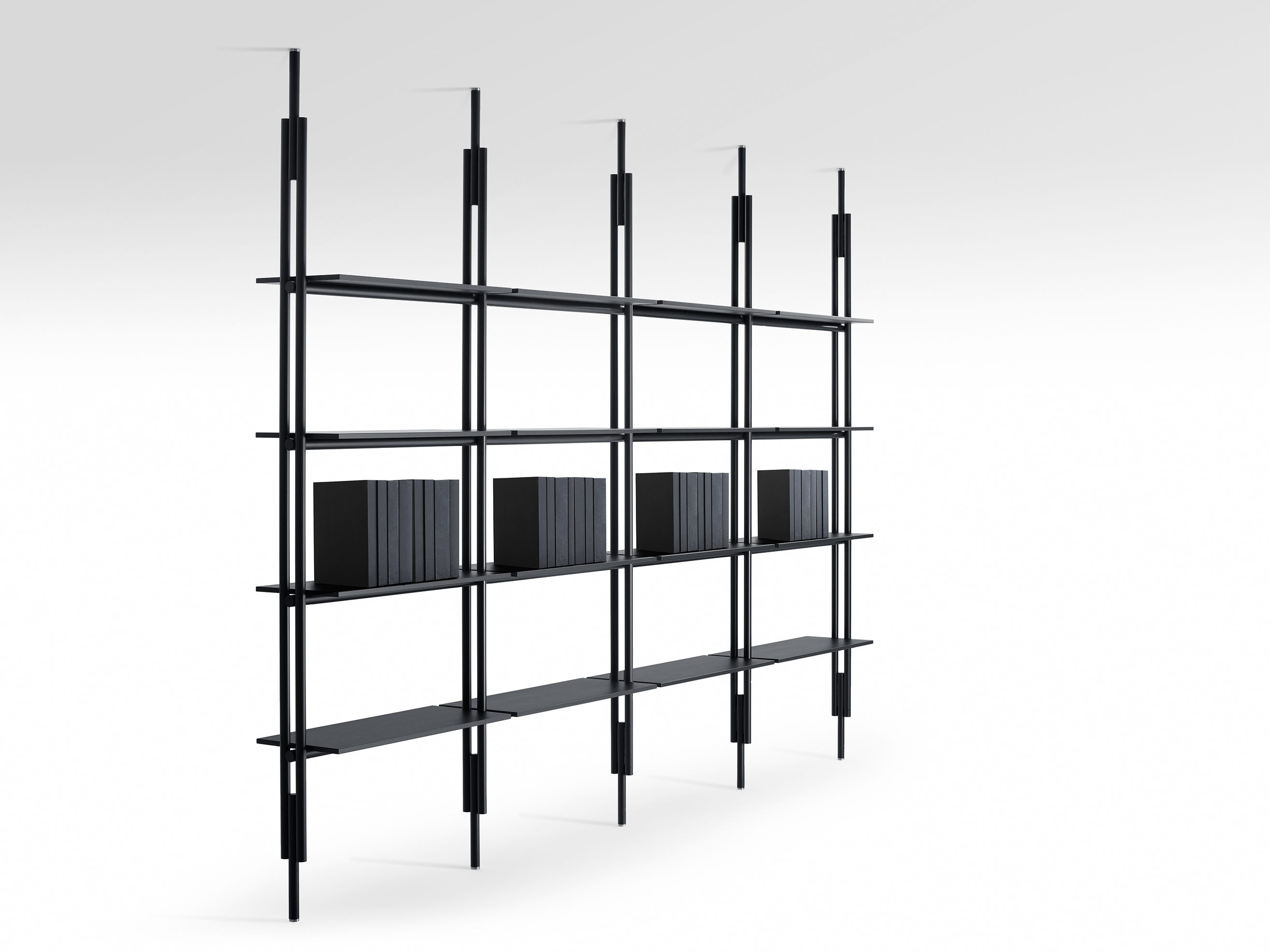 London-based Cypriot designer Michael Anastassiades modernizes a classic design for B and B Italia -- the 1950s room center bookcase, transforming it into a clean, minimal, architectural structure available in matte black or white. Engineered supports are concealed in the design, inside vertical elements with a rounded section made of extruded aluminum and integrated by an invisible floor-to-ceiling telescopic adjustment system, which is available in 14 heights, ranging from 86.6 to 127.5 inches. Shelves come in two lengths, 29.5 inches and 35.4 inches, just shy of 12 inches deep with two finishes. For vertical elements and shelves.
