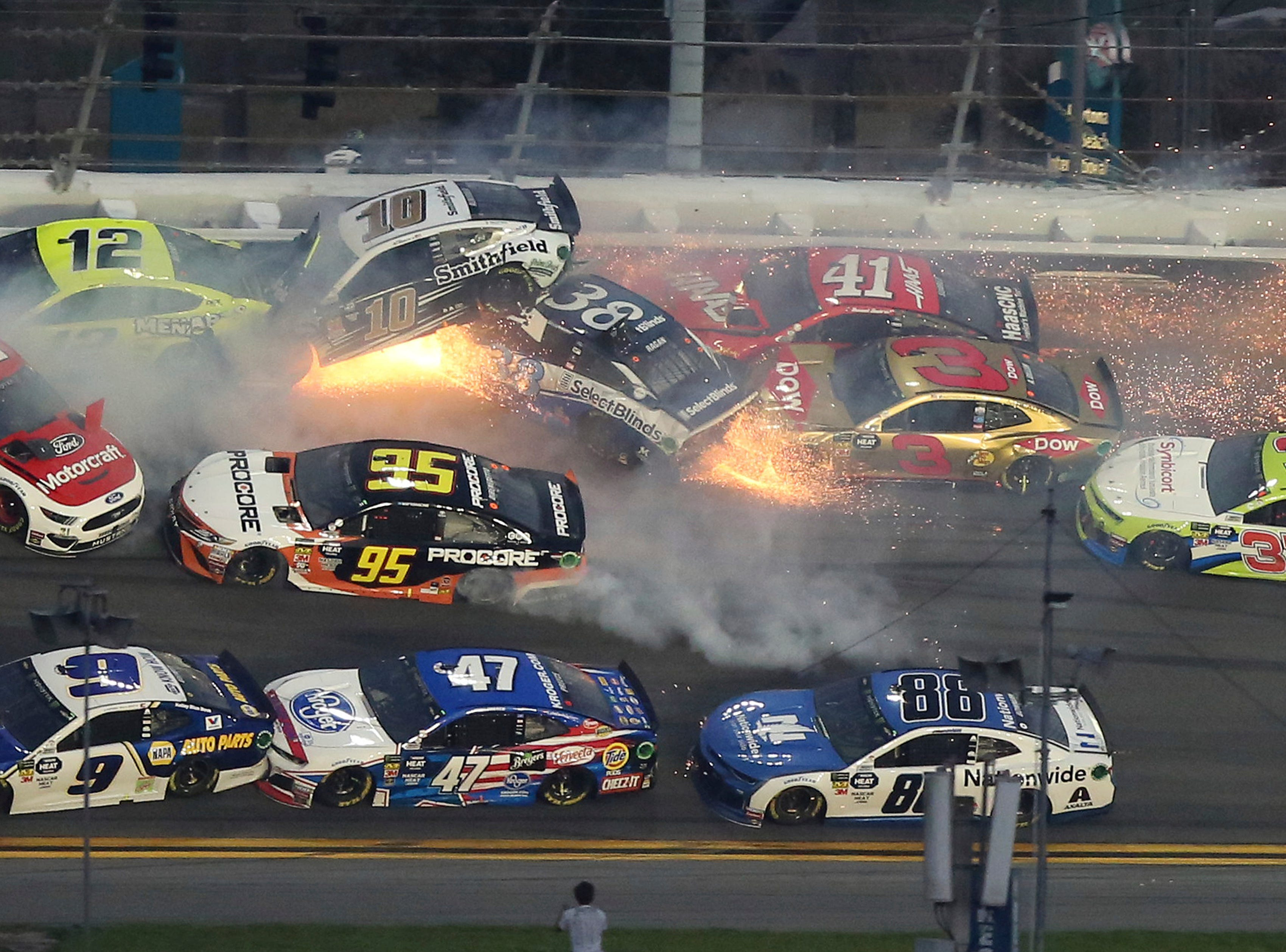 Multiple cars crash during a NASCAR Daytona 500 auto race Sunday, Feb. 17, 2019, at Daytona International Speedway in Daytona Beach, Fla.