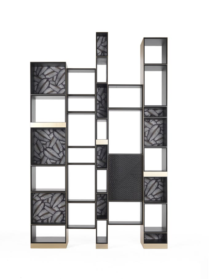 From the fashion brand Roberto Cavalli: shelving with a bit of pop tropical pattern. Acapulco is a study in asymmetry -- a modular system in varying widths, with double-side usage. The solids and voids create a unique composition. The solid pieces are clad in black embroidered leather as well as Dakota silk in a banana leaf print.
