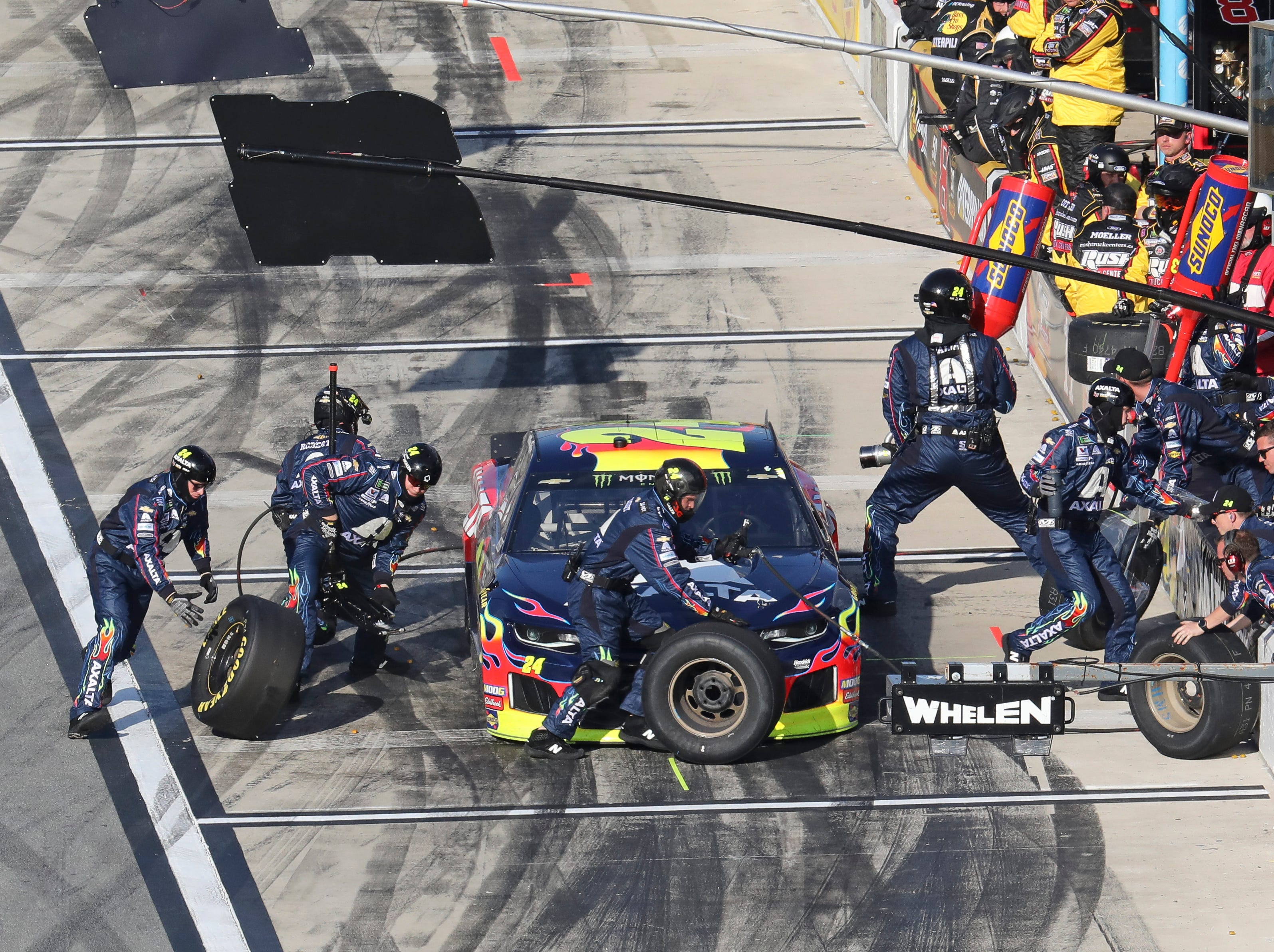 William Byron adds fuel and tires during a pit stop during a NASCAR Daytona 500 auto race at Daytona International Speedway.