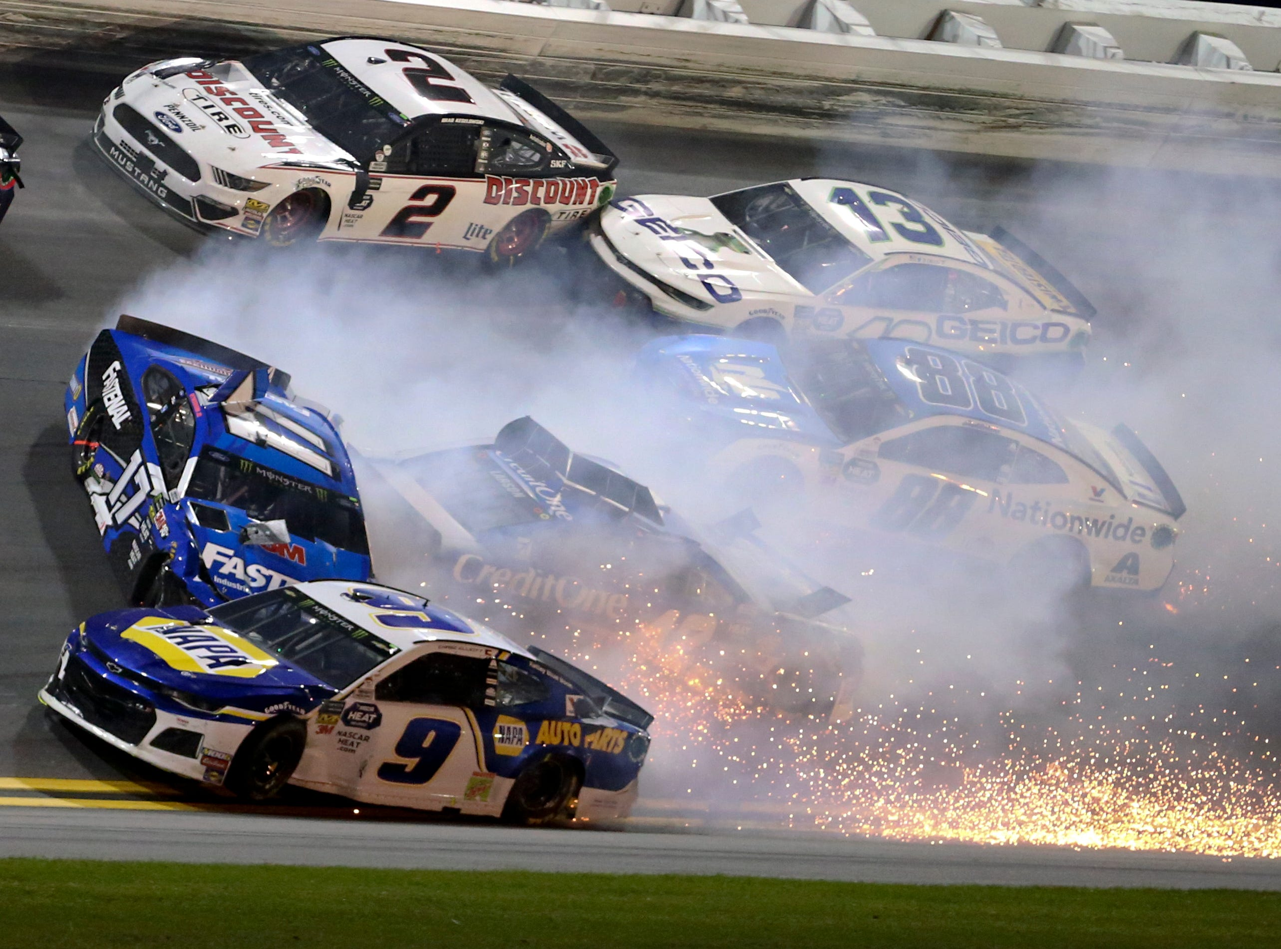 Chase Elliott (9), Ricky Stenhouse Jr. (17), Brad Keselowski (2), Kyle Larson (42), Ty Dillon (13) and Alex Bowman (88) wreck in Turn 3 during the NASCAR Daytona 500 auto race at Daytona International Speedway.