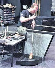 Eric Meek, senior manager of hot glass programs at the Corning Museum of Glass, works on a piece of blown glass at the museum. Meek is among several CMoG staffers who took part in a new Netflix show on glassblowing.