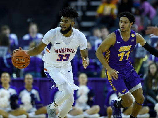 University of Evansville's K.J. Riley (33) dribbles down the court during the second half against the University of Northern Iowa Panthers at Ford Center in Evansville, Ind., Sunday, Feb. 17, 2019. The Purple Aces fell 73-58 to the University of Northern Iowa Panthers.