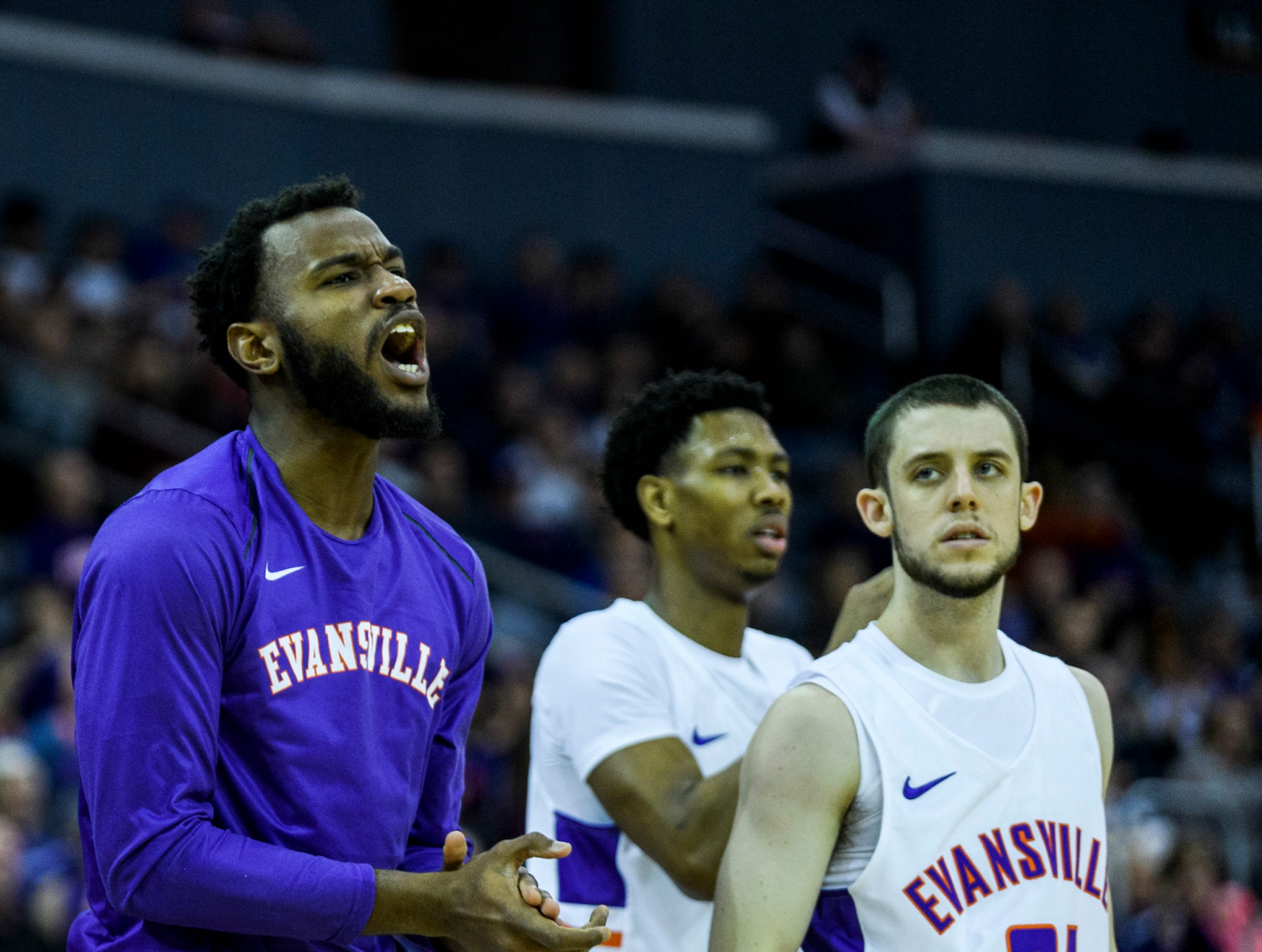 University of Evansville's John Hall (35), Marty Hill (1) and Shea Feehan (21) watch their team take on the University of Northern Iowa Panthers at Ford Center in Evansville, Ind., Sunday, Feb. 17, 2019. The Purple Aces fell 73-58 to the University of Northern Iowa Panthers.