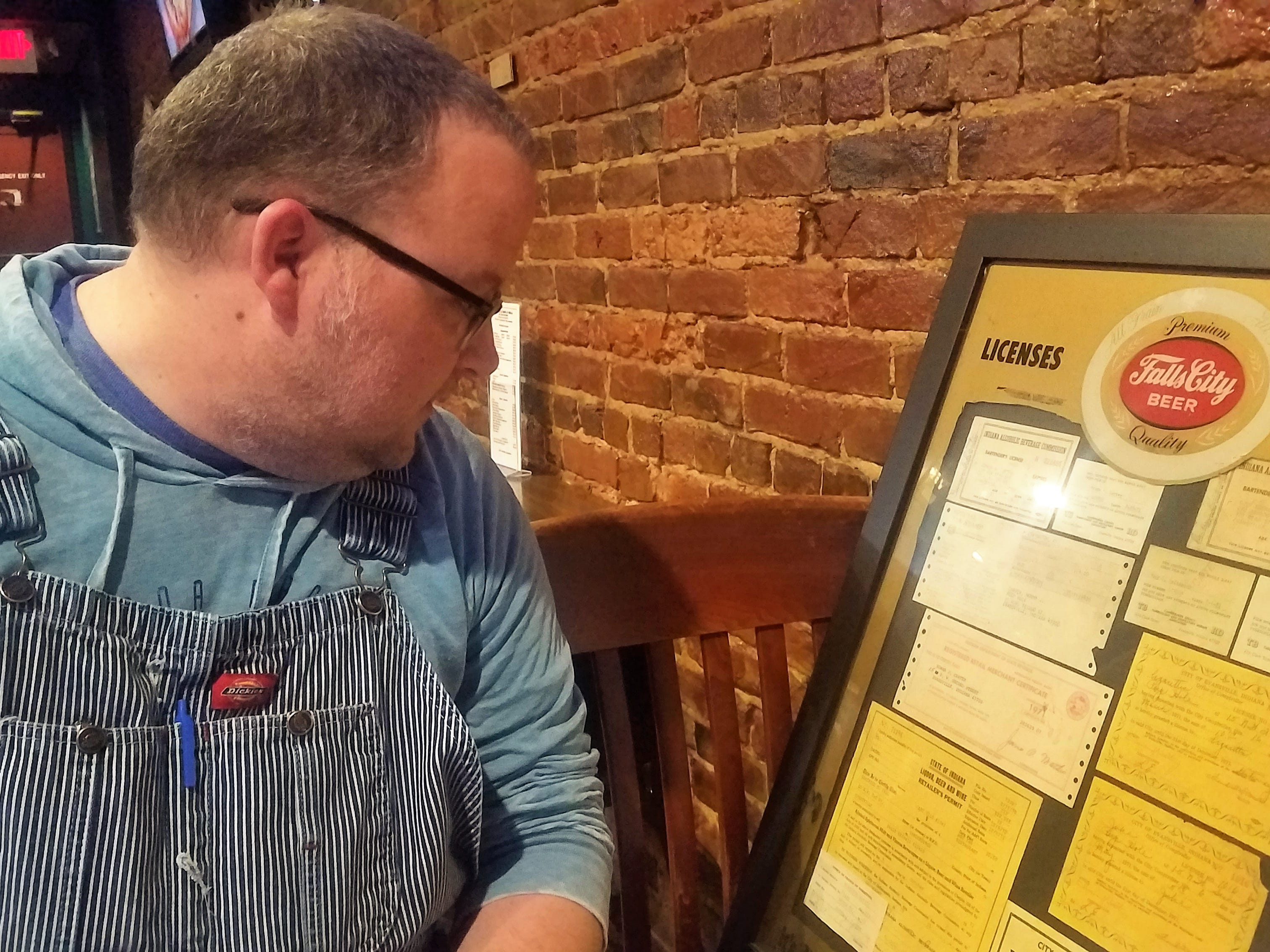 "Bar ""dad"" J.T. Norris traces the history of the Peephole through old permits and licenses."