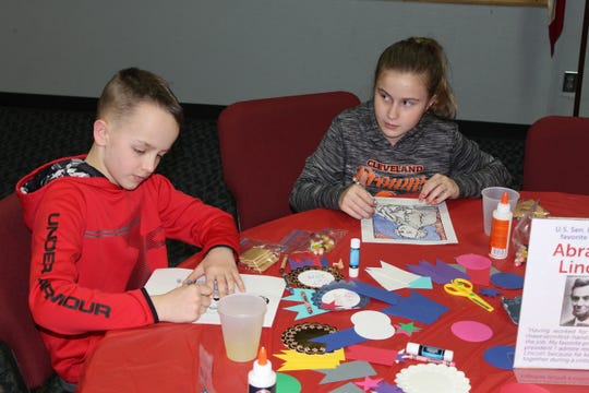 Kenna Tooman, 12, right, and Owen Tooman, 10, of Fremont color pictures of U.S. presidents Monday at the Rutherford B. Hayes Presidential Library and Museums. The Hayes presidential center held a celebration for Presidents Day.