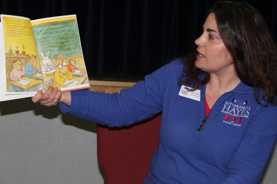 """Christie Weininger, executive director at the Rutherford B. Hayes Presidential Library and Museums, reads """"Arthur Meets the President"""" Monday at the Hayes conference room as part of the center's Presidents Day activities."""