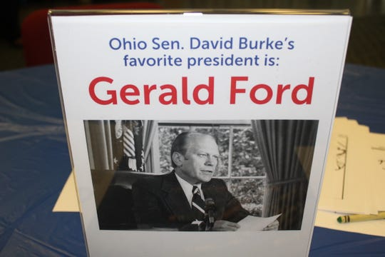 Signs with photos of Ohio politicians' favorite presidents were placed on every table in the Rutherford B. Hayes Presidential Library and Museums' conference room Monday as part of the center's annual Presidents Day celebration.