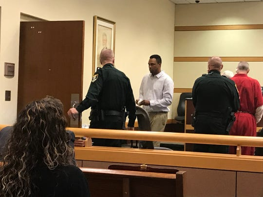 Former Mariner High School teacher and boys basketball coach James Harris leaves the Lee County courtroom of Judge Joseph Fuller after he plead guilty Monday to one count of sexual assault in a school. He was given an 11 year sentence in state prison.