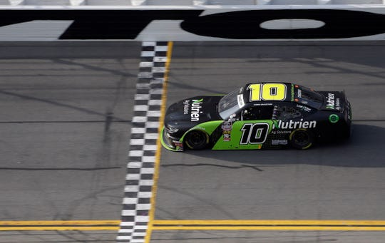 Ross Chastain (10) crosses the finish line to win the second stage of the NASCAR Xfinity auto race Saturday, Feb. 16, 2019, at Daytona International Speedway in Daytona Beach.
