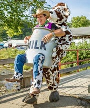 Entertainer Todd Charles, also known as The Moogician, has a cow-themed act that includes cheese-juggling, disappearing milk and a costume that makes it look like a cow is carrying him around in a giant milk can.