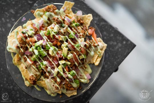 Vegan nachos from Buddha Blends feature ground walnuts and queso made from cashews.