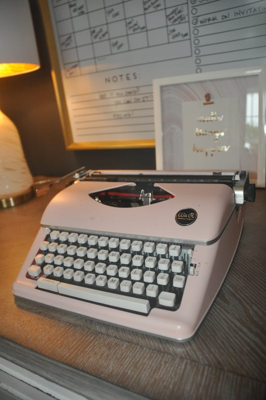 The den is decorated with some retro items such as this old typewriter.