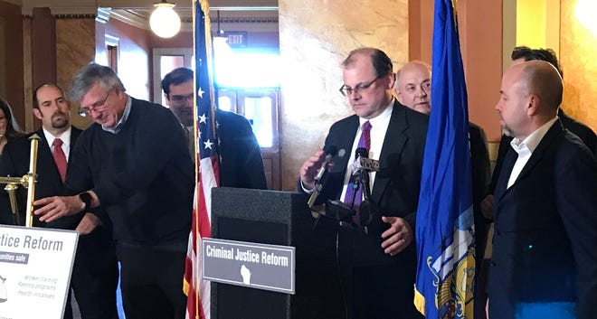 Wisconsin Rep. Michael Schraa, R-Oshkosh, prepares to address reporters Monday at the Brown County Courthouse in Green Bay. He and other Assembly Republicans called on Gov. Tony Evers to allocate funds to increase staffing for prosecutors, boost pay for public defenders and assistant DAs, retain corrections officers, and expand alcohol and drug treatment and diversion programs.