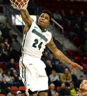 University of Wisconsin-Green Bay guard Keifer Sykes dunks the ball on a breakaway against the University of Minnesota-Duluth at the Resch Center in 2014.