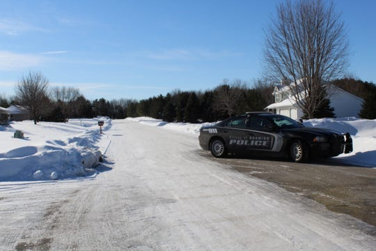 A police car blocks traffic near the intersection of Fairview Road and Mystic Hills Terrace in Suamico after a shooting that left one person dead and another injured.