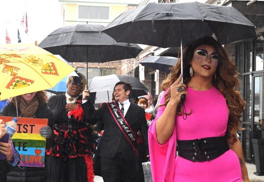 A drag queen who provided the name Princess Mocha walks with others in drag to Five Forks Branch Library for Drag Queen Story Hour Sunday, Feb. 17, 2019.