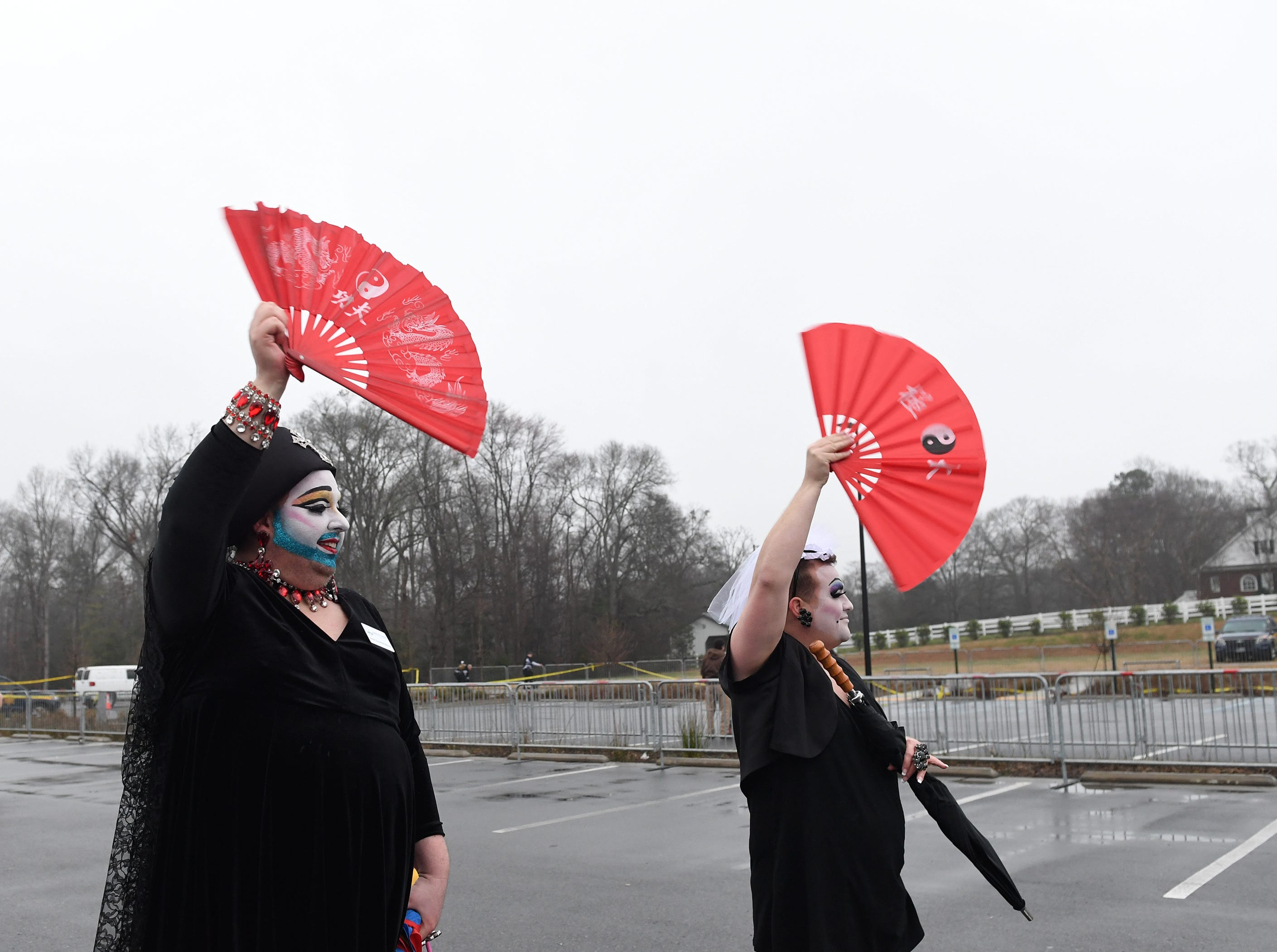 People gathered in support of Drag Queen Story Hour at Five Forks Branch Library cheer as some of the last attendees leave the library Sunday, Feb. 17, 2019.