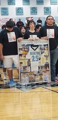 Members of Brayden Jackson's family, including his brother Blue Fettig (center) holding the case that holds Brayden's now-retired number 25 during ceremonies last week at Frazer High School. A standout player for the Bearcubs, Jackson died in a tragic accident last September at age 18.