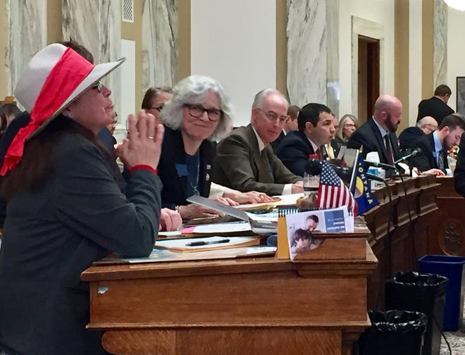 Rep. Rae Peppers, D-Lame Deer, left reacts as votes are tallied in favor of Hanna's Act in the state House.
