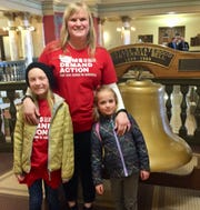 Kiely Lammers of Billings stands with daughters Ruby, 10, left and Tillie, 6.