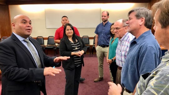 Acting Gov. Josh Tenorio, left, confers with representatives of engineers and architects groups Monday morning at Adelup, after signing a proclamation declaring Feb. 17 to 23 as Engineers, Architects and Land Surveyors Week. Tenorio later in the week will sign an executive order that will help shorten and modernize government of Guam's permitting process.