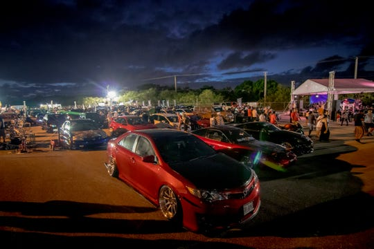 Hundreds of participants check out the cars displayed at the Battle Showcase held at Guam International Raceway in Yigo on Feb. 16.