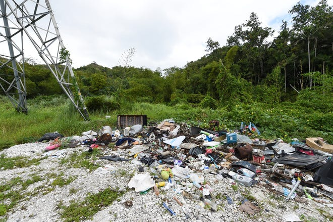 Trash is illegally dumped at the end of a roadway near a high tension tower in Agana Heights in this Feb. 18 file photo.