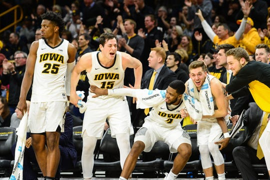 Iowa players (from left: Tyler Cook, Ryan Kriener, Isaiah Moss, Jordan Bohannon and Riley Till) have had a lot to be excited about in February, with a 4-0 record that includes three tight wins and a rout of No. 5 Michigan.