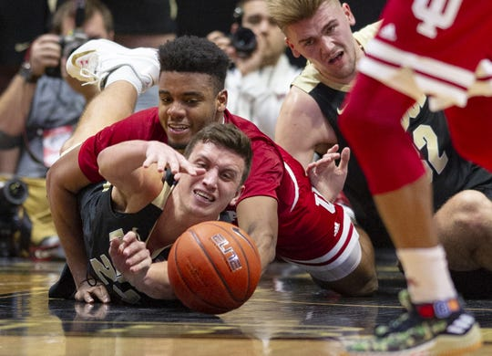 Purdue forward Grady Eifert (24) and Hoosiers forward Juwan Morgan (13) battle for a loose ball during the second half, Jan. 19, 2019. Purdue won 70-55.