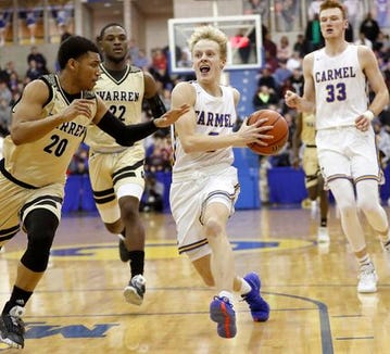 Carmel knocked off Warren Central 69-52 on Friday night.