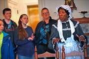 Robin Bankhead, right, playing as Dolly, the cook, leads a tour at the Benjamin Harrison Presidential Site, Monday, Feb. 18, 2019.