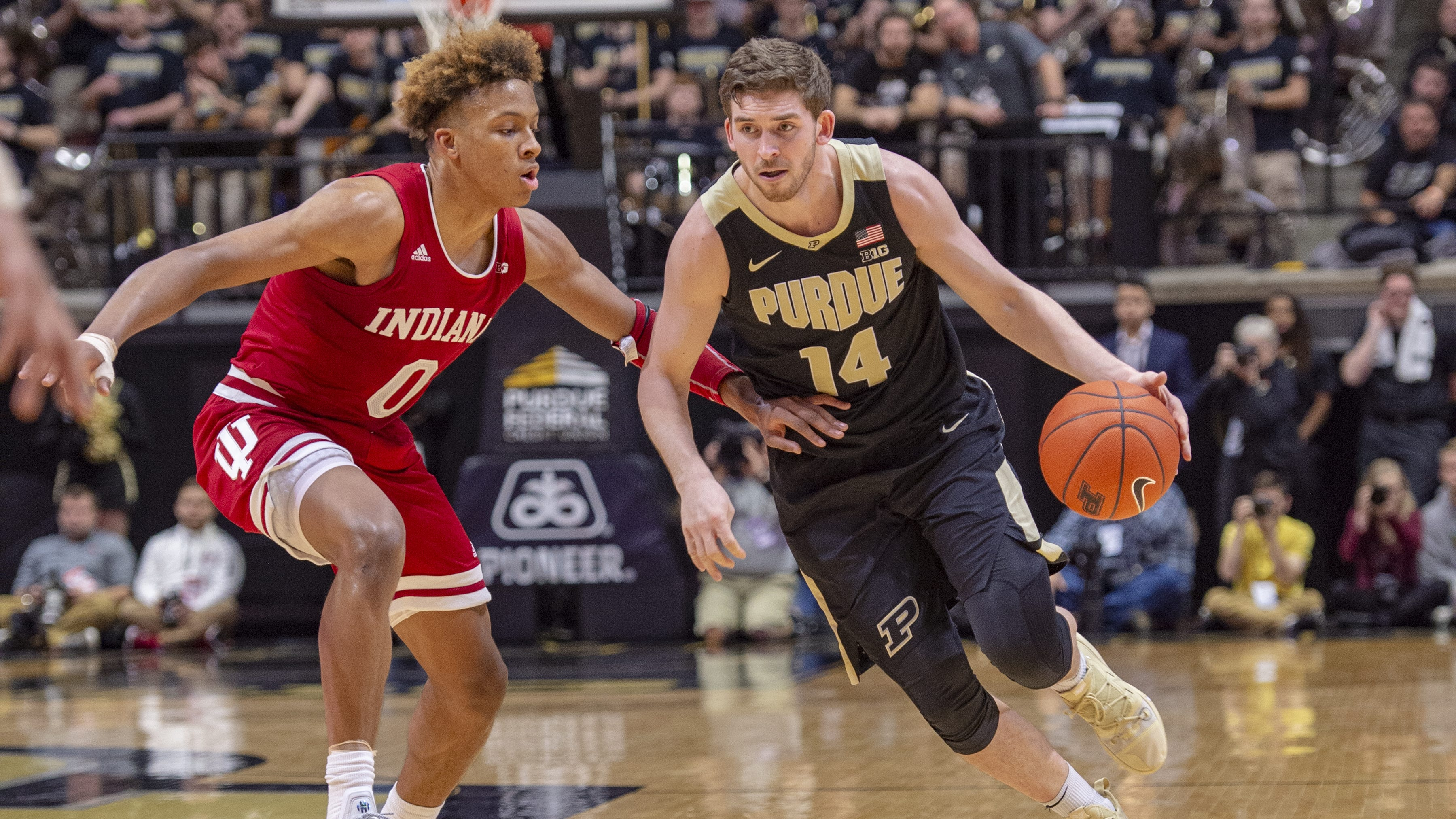 Purdue guard Ryan Cline (14) makes a move around Hoosiers guard Romeo Langford (0) in the Boilers' 70-55 earlier this season.