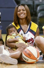 In this 2002 file photo, Niele Ivey poses with son Jaden, four months.