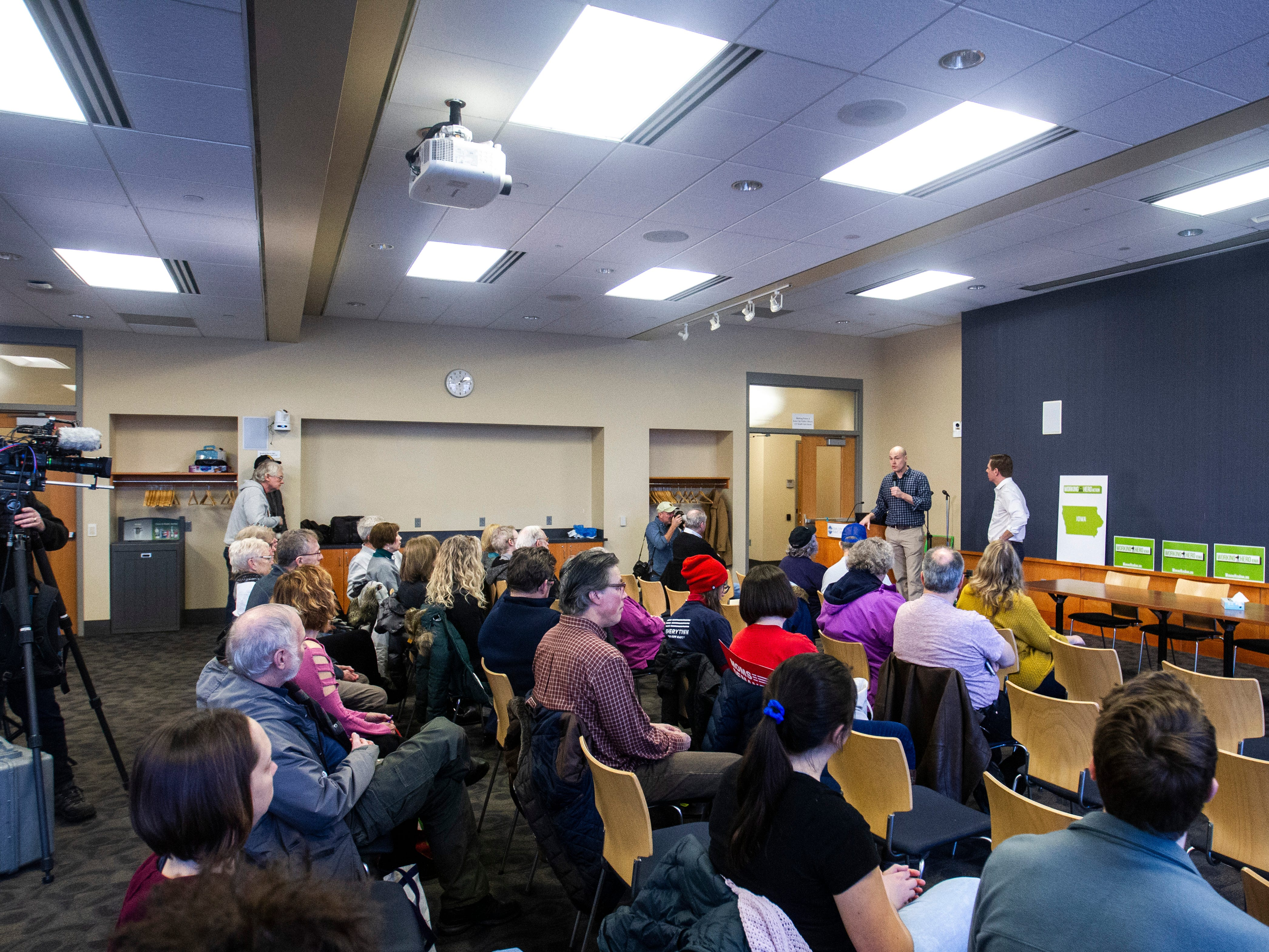 J.D. Scholten, Working Hero Iowa director, (left) introduces U.S. Rep. Eric Swalwell, D-Calif., during a Working Hero Iowa event on Monday, Feb. 18, 2019 at the Public Library in Iowa City, Iowa.