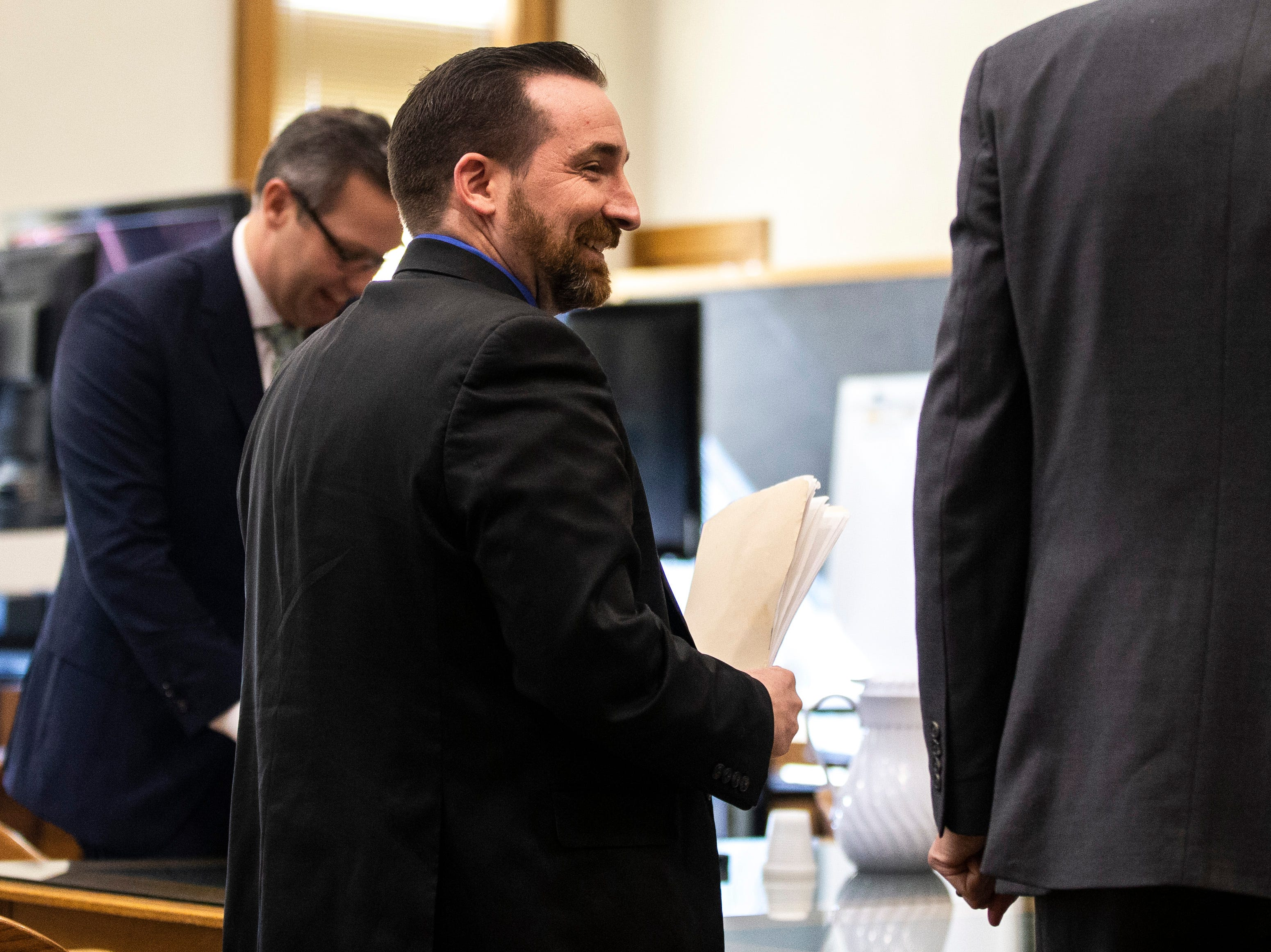 Judge Jason Besler, left, collects papers after a pre-litigation hearing, Monday, Feb. 18, 2019 at Johnson County Courthouse in Iowa City, Iowa.