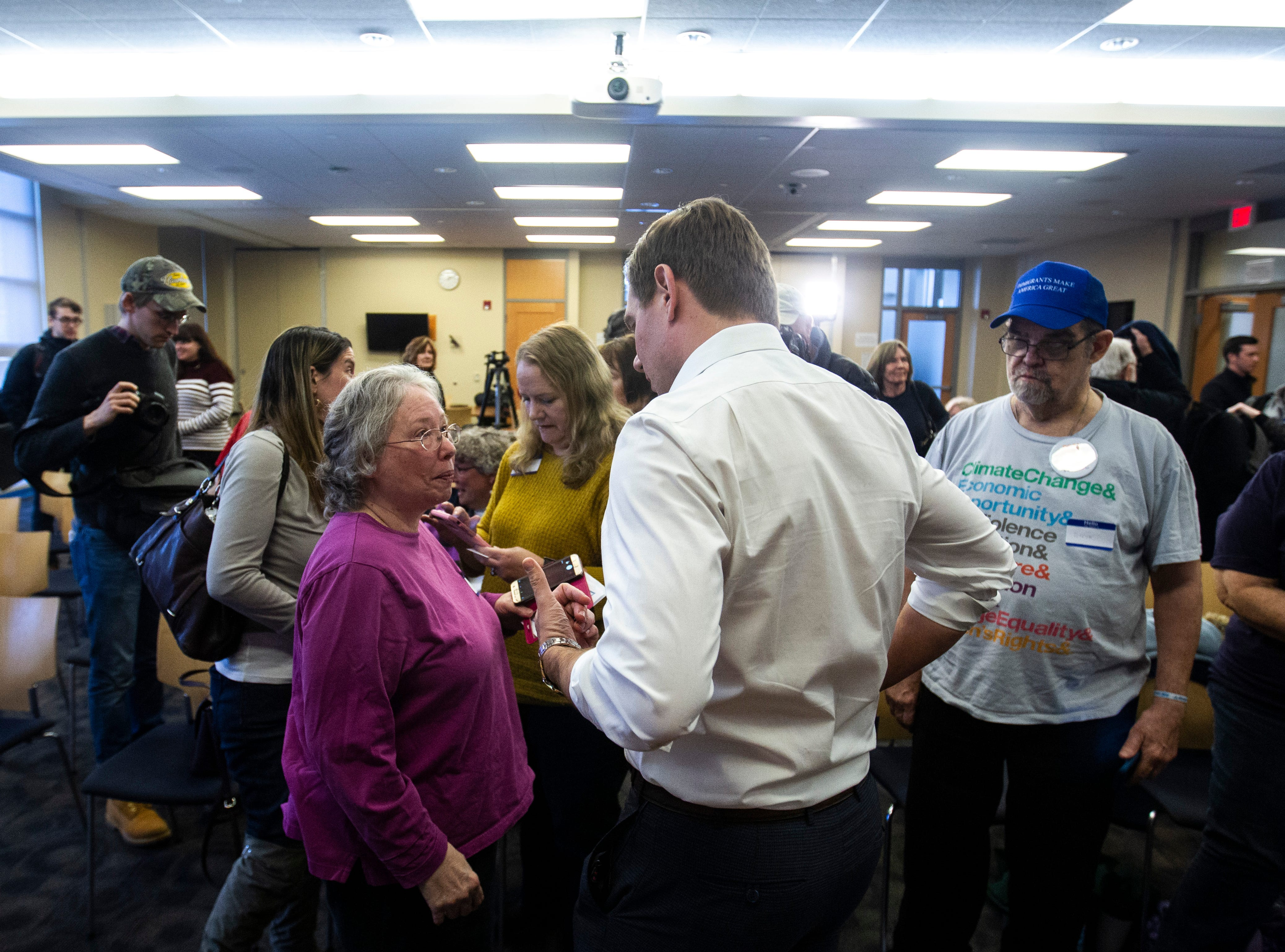 U.S. Rep. Eric Swalwell, D-Calif., talks with community members after a Working Hero Iowa event on Monday, Feb. 18, 2019 at the Public Library in Iowa City, Iowa.