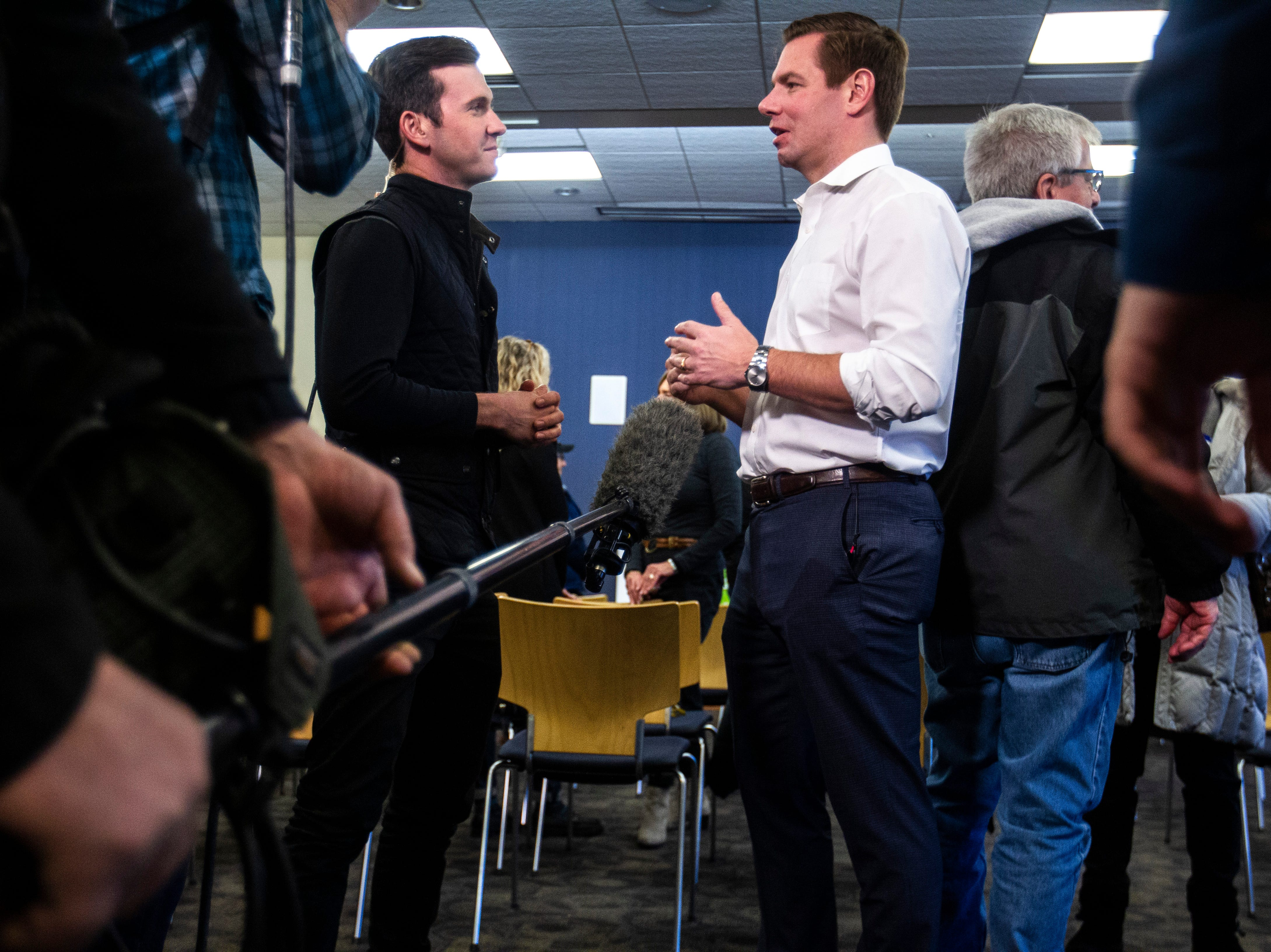U.S. Rep. Eric Swalwell, D-Calif., speaks during an interview with MSNBC after a Working Hero Iowa event on Monday, Feb. 18, 2019 at the Public Library in Iowa City, Iowa.