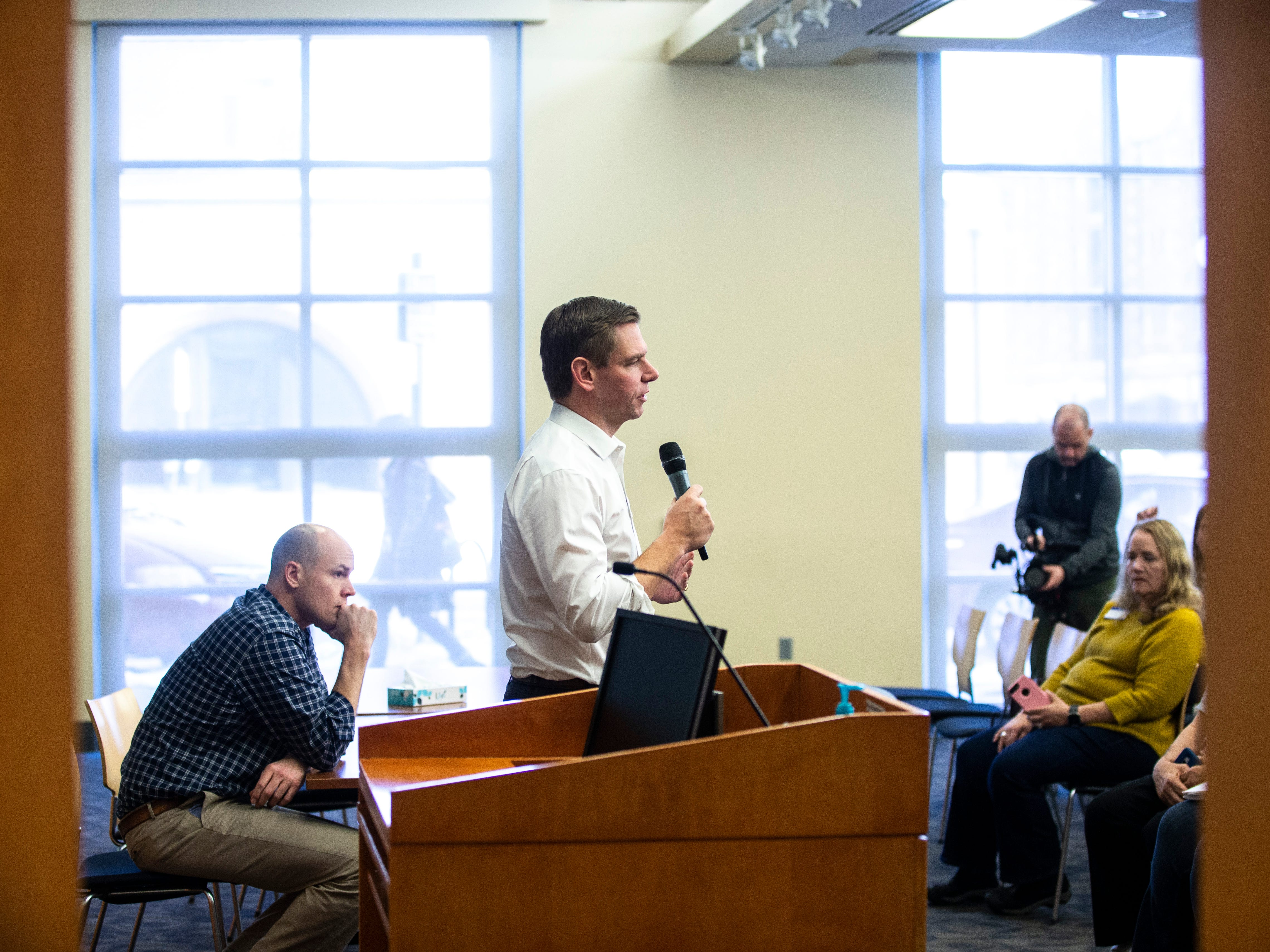U.S. Rep. Eric Swalwell, D-Calif., speaks during a Working Hero Iowa event on Monday, Feb. 18, 2019 at the Public Library in Iowa City, Iowa.