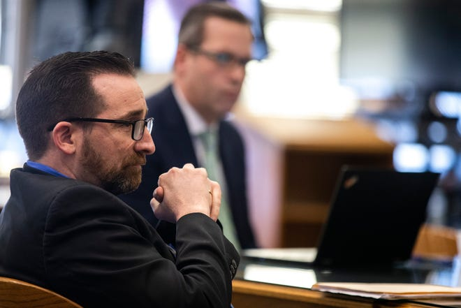 Judge Jason Besler, left, listens during a pre-litigation hearing, Monday, Feb. 18, 2019 at Johnson County Courthouse in Iowa City, Iowa.