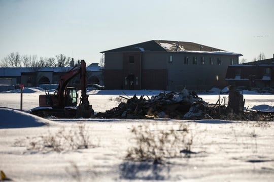 Demolition continues while crews work to clear the future site for the Johnson County Behavioral Health Access Center on Monday, Feb. 18, 2019 in Iowa City, Iowa.
