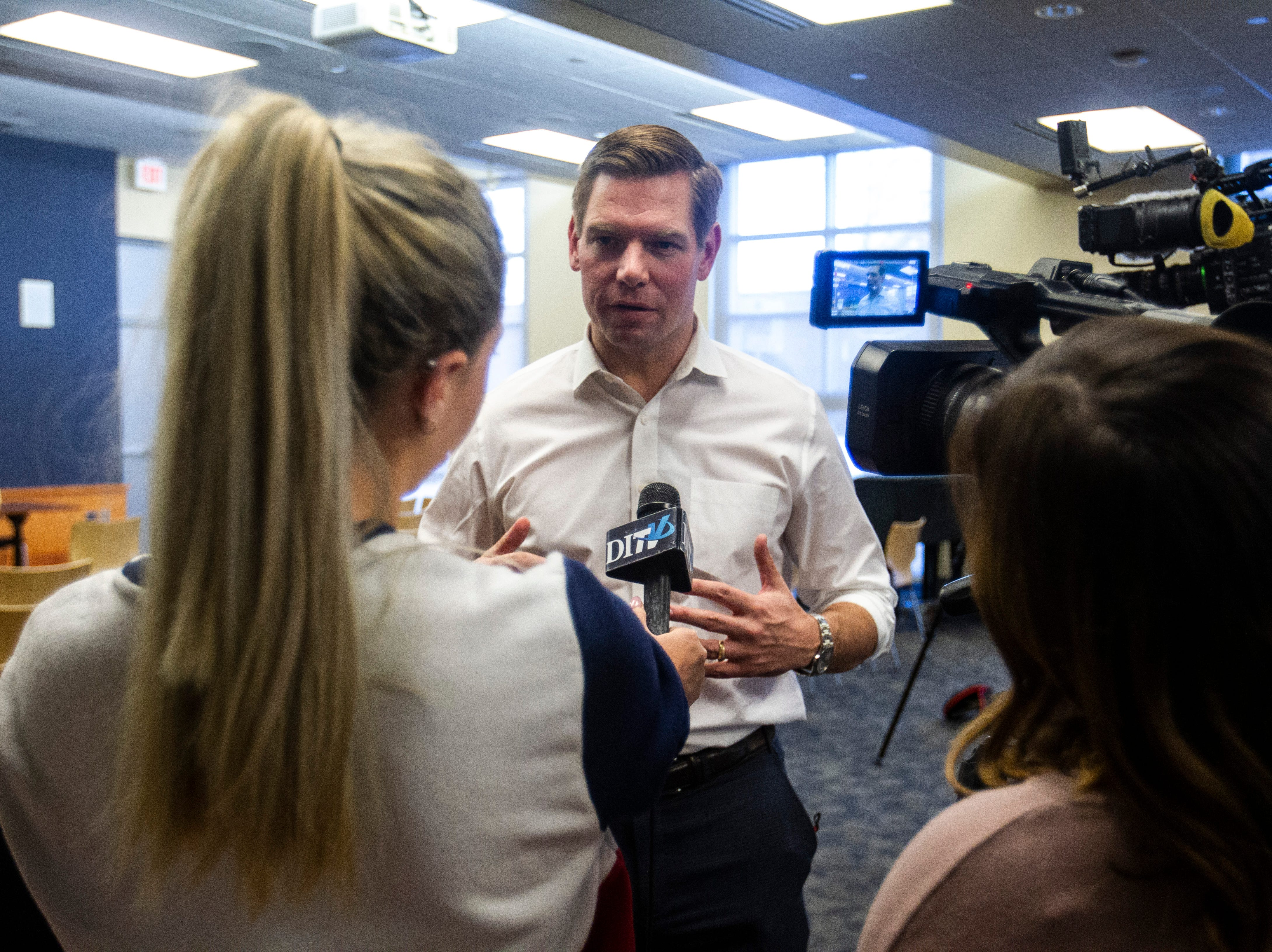 U.S. Rep. Eric Swalwell, D-Calif., speaks during an interview with DITV, the independent student-run broadcast associated with The Daily Iowan newspaper on the University of Iowa campus, after a Working Hero Iowa event on Monday, Feb. 18, 2019 at the Public Library in Iowa City, Iowa.