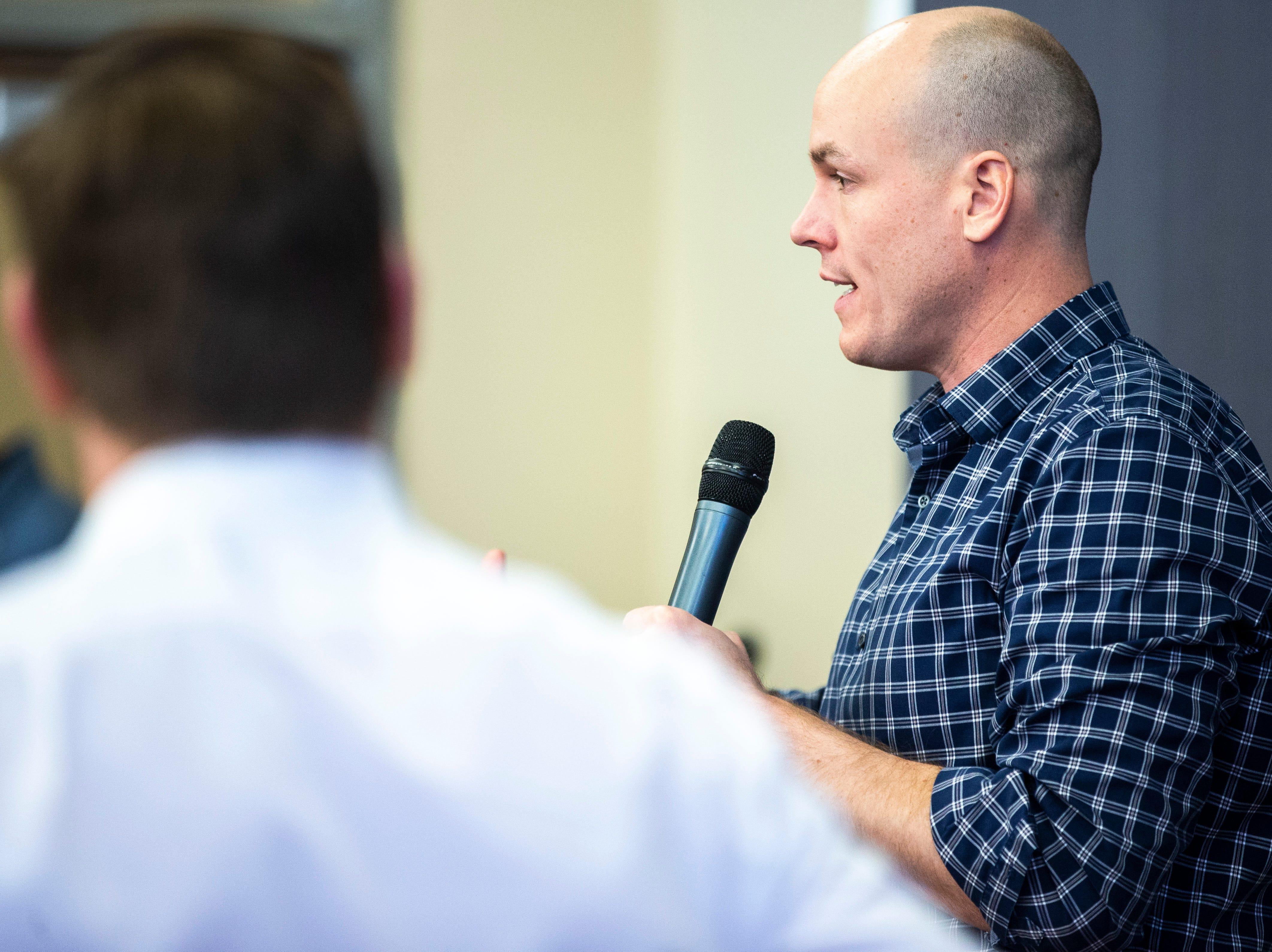 J.D. Scholten, Working Hero Iowa director, speaks during a Working Hero Iowa event on Monday, Feb. 18, 2019 at the Public Library in Iowa City, Iowa.