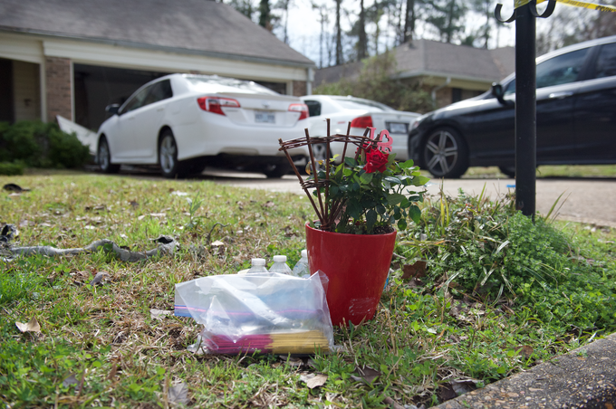 In this February 18, 2019 photo, relatives placed a memorial in front of a Clinton home, where four were found dead after a 12-hour standoff with law enforcement on Saturday, Feb. 16, 2019.  A suspect, Nam Quang Le, 34, was shot and later died at a hospital.