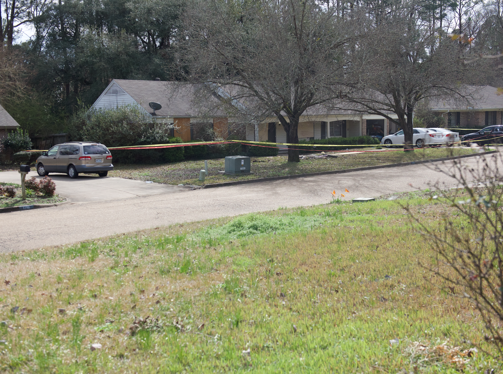 In this February 18, 2019 photo is a view of the home where four were found dead after a 12-hour standoff with law enforcement on Saturday, Feb. 16, 2019.  A suspect, Nam Quang Le, 34, was shot and later died at a hospital.